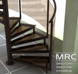 Стеклянные детали винтовой лестницы (ступени и заполнения ограждений), выполнены в одной цветовой гамме,  сочетающейся с интерьером помещения