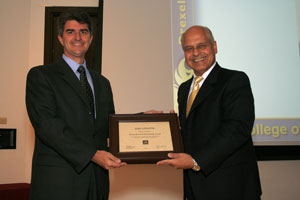 Dean of the engineering centre Dr. S.Gucheri (right) presents Professor Yury Gogotsi, Trustee Chair Professor of Materials Science and Engineering Director, AJ Drexel Nanotechnology Institute (left) with the highest Drexel University Award 2009.
